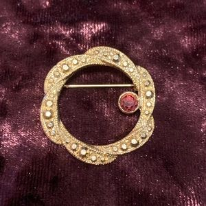 Round gold tone with red rhinestone brooch. 2/$10